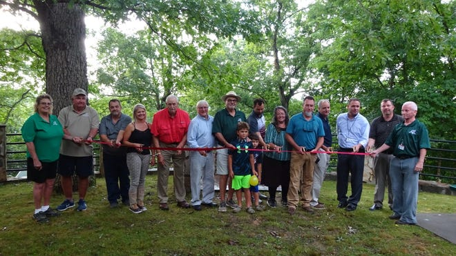 On July 13, the Davidson County Board ofCommissioners held a ribbon cutting at Boones Cave Park in Lexington. Alongwith members of the Board of Commissioners, there were many representativesfrom the Davidson County Parks and Recreation Commission and county management staff in attendance at the ribbon cutting. The improvements madeat the park include an 18-hole disc golf course, the installation of a canoe/kayakroad down to the Yadkin River and installation of a new playground.