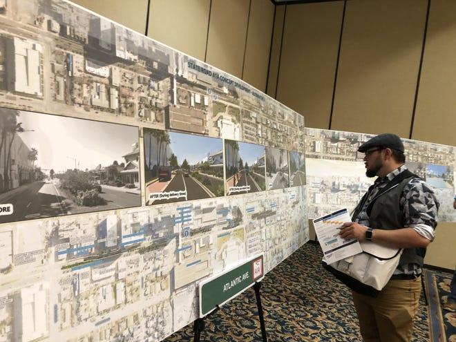 Richard Martinez, a Daytona Beach resident, studies proposed changes to Atlantic Avenue during a community meeting at  The Plaza Resort and Spa on Thursday, July 15, 2021.