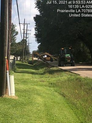 Ascension Parish vegetation management crews cut grass in roadside ditches