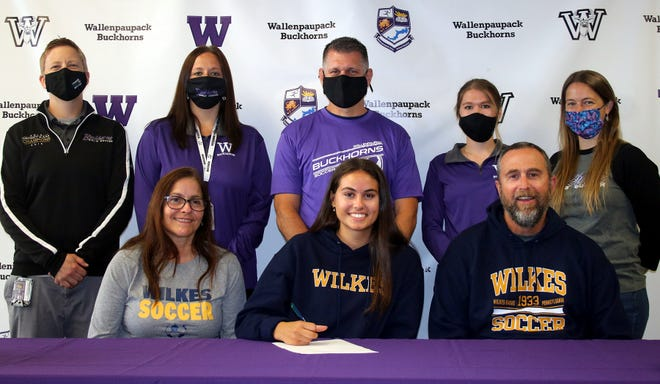 Wilkes University bound! Wallenpaupack Area's Aliah Balch was joined by her mother Jill and father, an Assistant boys soccer coach, Tim, as she committed to continue her academic and athletic careers with the Colonels. Also on hand (back row) were girls assistant coach Katie Schkolenko, girls hea coach Alicia Sodano, boys head coach Scott Bonagura, girls assistant coach Emily Kotcho, and girls junior high coach M'Liss Bonagura.