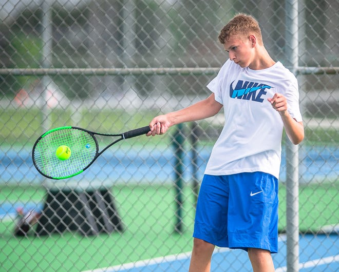 Blue Springs South Nathan Scherer competes in singles play in the Summit Slam tournament Friday at Lee's Summit North High School.