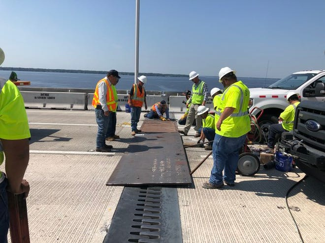 FDOT workers install temporary steel plates on May 27 on the southbound side of the Buckman Bridge.