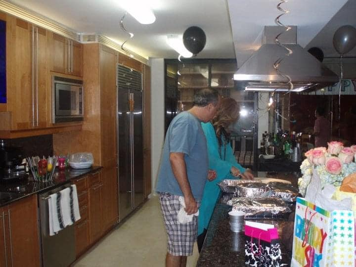 Manny and Adriana LaFont seen in the Unit 801 kitchen for a birthday party