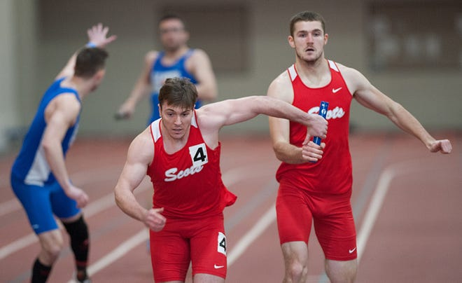 Former West Central All-Stater Zach Vancil passes the relay baton to Lucas Sondgeroth at a Monmouth College indoor track and field meet.