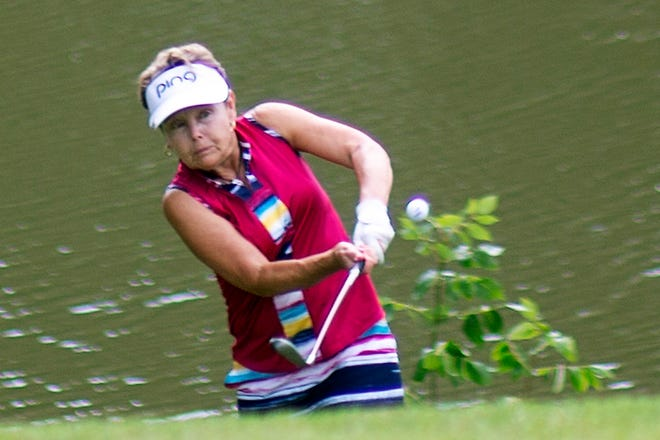 Lorraine Gottenborg hits a chip shot onto the 11th green at Lake Bracken Country Club during the second round of the Galesburg Women's All-City Golf Tournament on Wednesday, July 22, 2020.