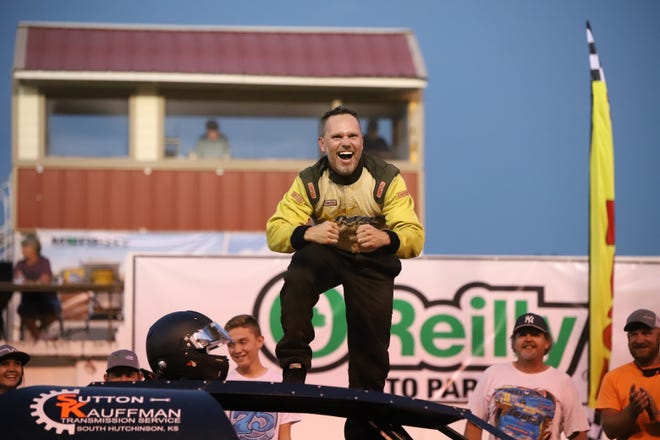 Hutchinson driver and operator of the 75-car Jerrod Reimer celebrates after winning the super stocks feature at the 65th Hutchinson Grand Nationals Auto Races at the Kansas State Fairgrounds Thursday.