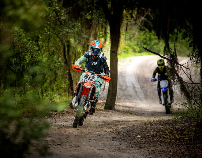 Motorcycle riders take to the trails at Bone Valley ATV Park south of Mulberry on Friday. The park, which is currently 200 acres, will be expanded soon to 500 acres.