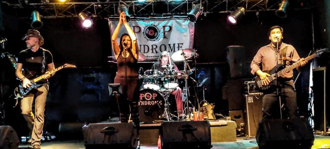 Monroe native Stephanie (Wilson) Restifo (center) and her band, Pop Syndrome, perform. Pop Syndrome is coming to Monroe County Community College July 31.