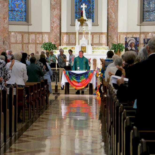 Joseph Cardinal Tobin, CSsR, of the Diocese of Newark, leads the congregation in prayer during a Mass celebrating the IHM's 175th anniversary.