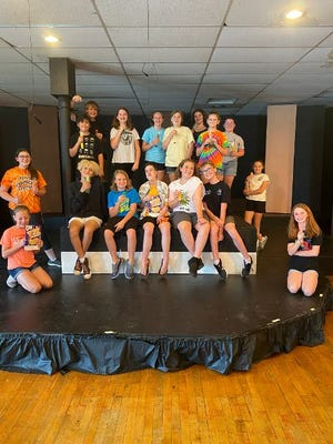 """Older campers pose for a picture during rehearsal for """"Willy Wonka Jr."""" The show will be staged July 23-34 at Spotlight Studio."""