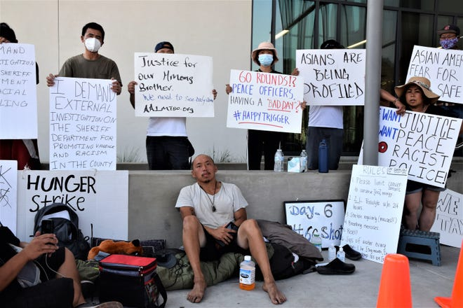 Surrounded by his supporters from the Mt. Shasta Vista Subdivision, Zurg Xiong sits in front of the county courthouse for the past week on a hunger strike in protest of the officer involved shooting of a Hmong man.