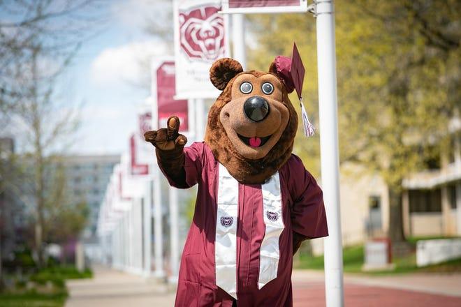 Boomer in graduation regalia around campus. Kevin White/Missouri State University