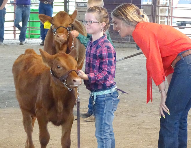 The interaction between judges and 4-H'ers in the show ring can be priceless. These two share a smile during the Franklin County bucket calf show.