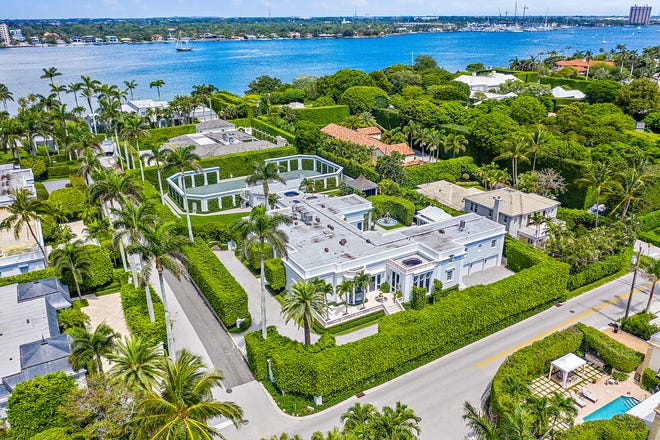 Built in 1973, a house with a walled tennis court at 301 Polmer Park just changed hands for a recorded $25 million on the North End of Palm Beach. The property is already being marketed with a new price of $34.85 million.