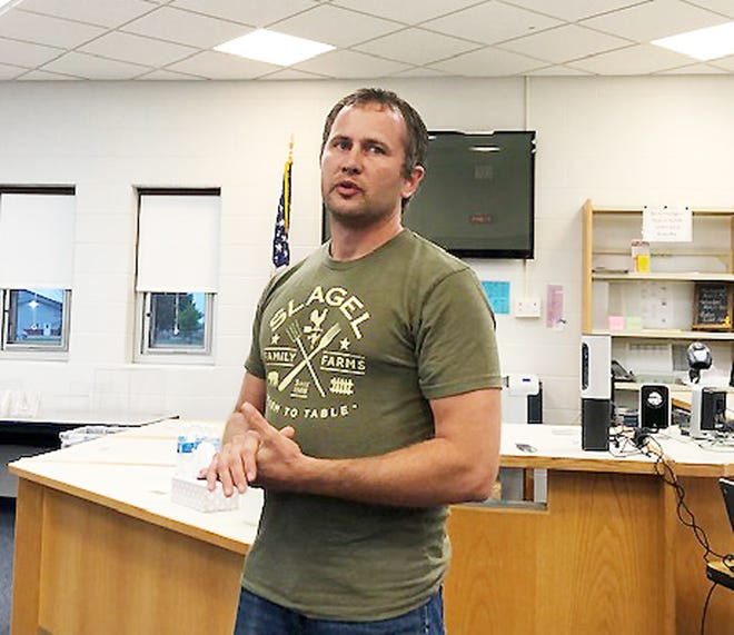 Louis John Slagel addresses the Prairie Central Board of Education during the regular July meeting Thursday.