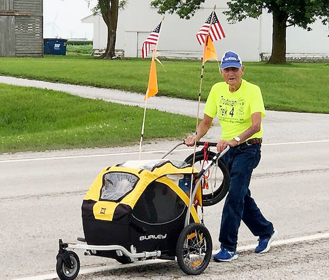 Dean Troutman of Princeville walks along U.S. Route 24 between Chenoa and Weston Thursday morning making his way toward Fairbury.