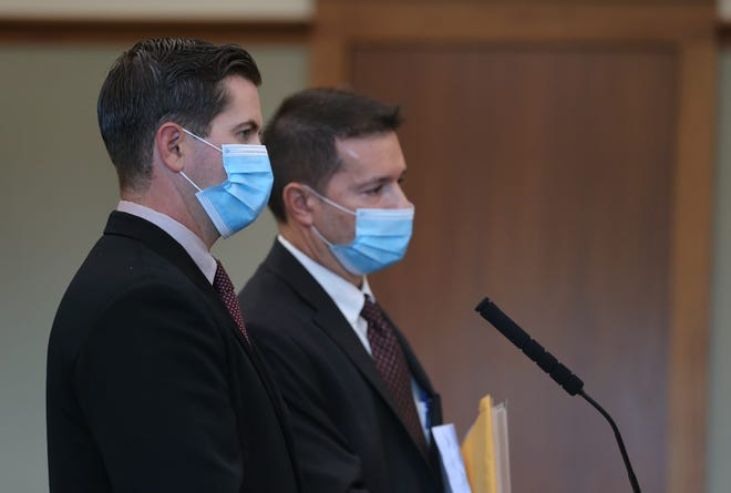 Officer Daniel Dolan Jr., left, appears in court alongside his attorney, Michael J. Collucci, on Friday.