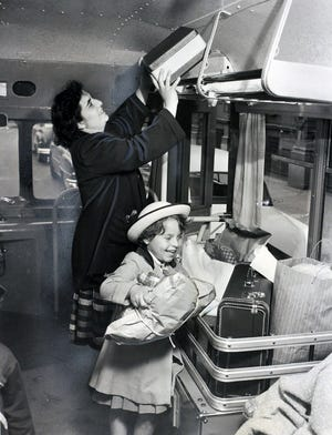 In 1953, Mrs. Edward Ashodian and her daughter Kathy, 5, board a United Transit bus for a weekly shopping trip. It operated in the Sandy Lane section of Warwick.