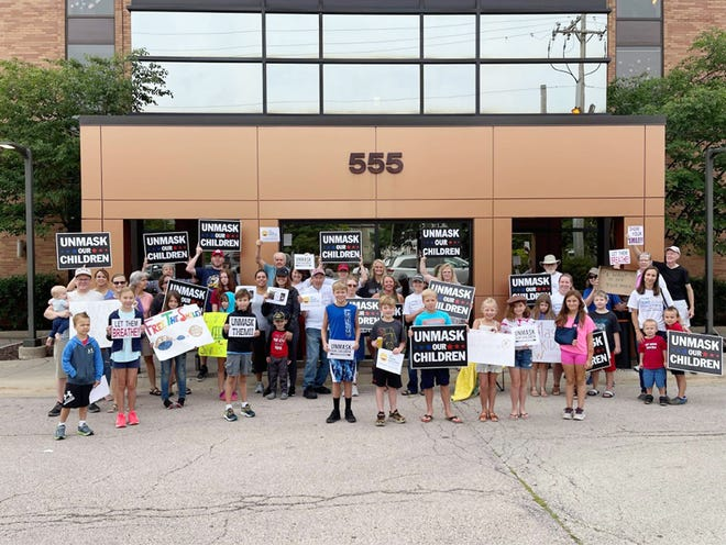 A group of about 40 Elevate and Inspire demonstrators held signs for about two hours outside of the Winnebago County Health Department on North Church Street  on Friday, July 16, 2021, in Rockford.