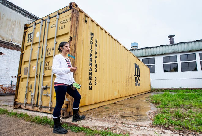 Ella D'Amico, executive director of the South Bend-based nonprofit ContainArt Community Inc., talks Friday at her 206 E. Tutt St. assembly facility about how her group plans to convert shipping containers into new homes in South Bend.