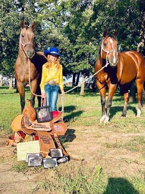 Stephenville's Maddison Hammond recently won the 2021 National Little Britches Little Wranglers world championship in barrel racing at the Lazy E arena in Guthrie, Oklahoma. Here she is pictured with her barrel horse, Handyman, and her pole horse, Slim Jim.