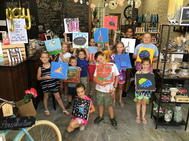 """Fourteen young, creative minds work hard on their arts and crafts projects while participating in the """"Go for the Gold"""" art camp at Pinspiration in Stephenville. They dove deep into their imaginations to create Olympic- and sports-inspired projects."""