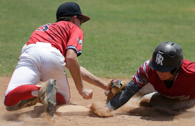 Ayden Shkorupa of the Sarasota 14-year-old All-Stars gets his hand back to third base before the East Bay tag in the second inning of Friday's winners' bracket game in the Florida Babe Ruth South State Tournament at the Sarasota BRL fields..