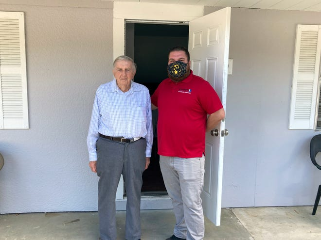 """Veteran Tom Halliwell, left, with Todd Hughes, Goodwill's Veterans Services Program manager. """"It is our duty to serve those who first served us,"""" Hughes said."""