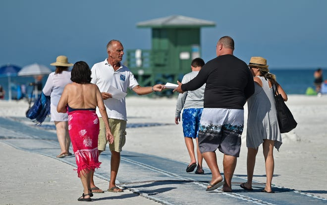 Jim Alfieri, on left, dedicating his time to bring lightning awareness to Siesta beachgoers on the one-year anniversary of Jacob Brewer, (then 14 years old) who was vacationing with his family at Siesta Key Beach when he was struck by lightning on the beach.