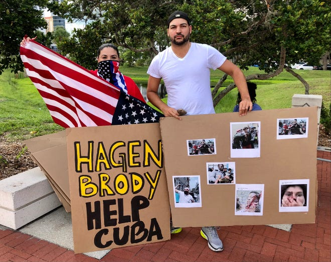 Ana Maria Milan, left, and Alejandro Rodriguez demonstrated in downtown Sarasota last week in solidarity with anti-government protesters in Cuba.