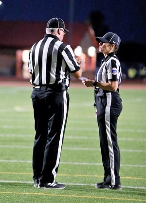 Carmen Doramus-Kinley is one of only a handful of female officials who officiate football in Kansas. Doramus-Kinley also works volleyball and basketball games.