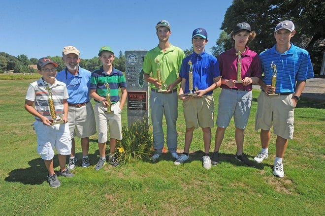 Tournament director Larry Masterson, second from left, stands with the 2016 Taunton Junior City Open winners.