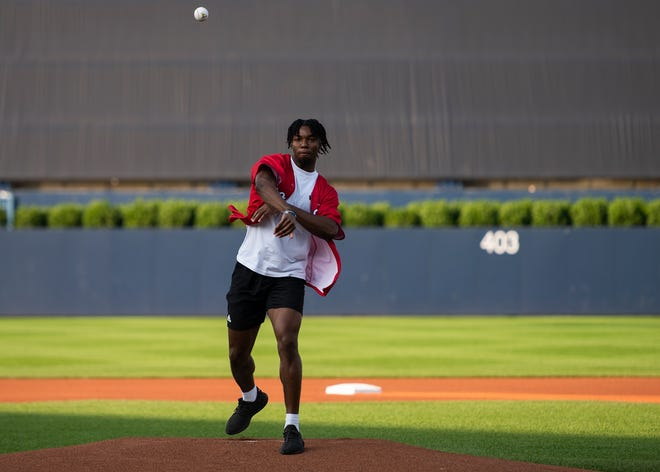 NFL draft pick Ifeatu Melifonwu of Graton throws out the ceremonial first pitch before Thursday night's WooSox game against Scranton/Wilkes-Barre at Polar Park. Melifonwu was drafted in the third round by Detroit Lions.
