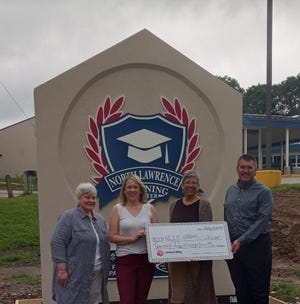 The United Way of South Central Indiana recently presented a $25,000 check to North Lawrence Community Schools for the STEAM program.  STEAM covers science, technology, engineering, arts and math, and plays a vital role in equipping our youth with the career and life skills they need to succeed.  Pictured from left:  Shellie Pritchett (Early Learning coordinator), Maggie Dainton (director of learning), United Way Executive Director Kim Burgess, and North Lawrence Community Schools Superintendent Ty Mungle.