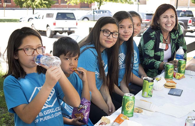 Angela Giron, President and CEO of the Boys & Girls Club of Pueblo County with members in July 2018.