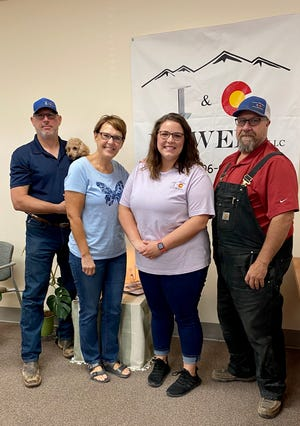 Robert and Lisa Moran (Left) Megan Shepherd (center) and Trevor Tate. Despite adversity, the Moran family has worked together to open I&C Power in Pueblo West.