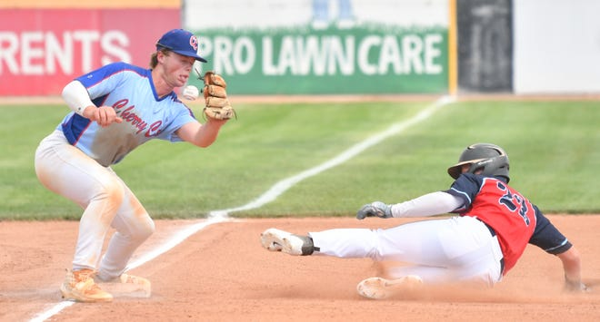 Cherry Creek's Lukes Dereki attempts a tag on a stealing 4-Corners' runner in the Tony Andenucio Memorial Tournament Thursday July 15, 2021 at the Runyon Sports Complex.