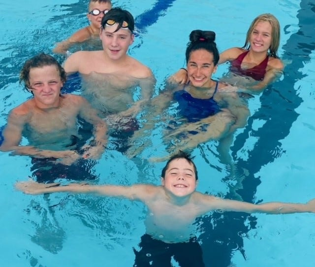 Wellington swimmers hanging out in there lane at practice