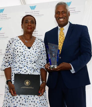Ed Gaskin, shown with Frederika Williams, was recognized as a Men's Health Champion at Whittier Street Health Center's 21st annual Men's Health Summit.