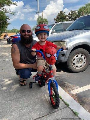 James Nance teaches his son Jameson, how to ride a bike.