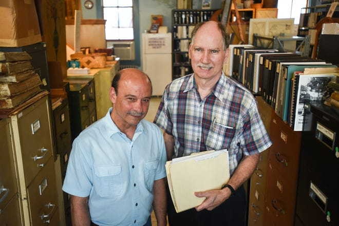 The Campbell County Historical & Genealogical Society in Alexandria, Ky is home to hundreds of local artifacts and records. The society's president, Steve Battistone (left) and local researcher, Steve Roth (right) stand together in the society's research room on Thursday July 15, 2021.