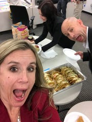 Katie Pecoraro, program management supervisor of the 2022 Ford Maverick, is seen with Tim Farmer, Maverick program manager, in 2019 on taco day in a secret work room where some 60 people worked together in record time.