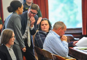 Steven Wayne Keefe looks on as his attorneys confer during a re-sentencing hearing in the Cascade County Courthouse on Friday, July 16, 2021.  Keefe is serving a life sentence for the 1985 murders of David J. McKay, his wife Constance McKay and their daughter Marian McKay Qamar in Great Falls.