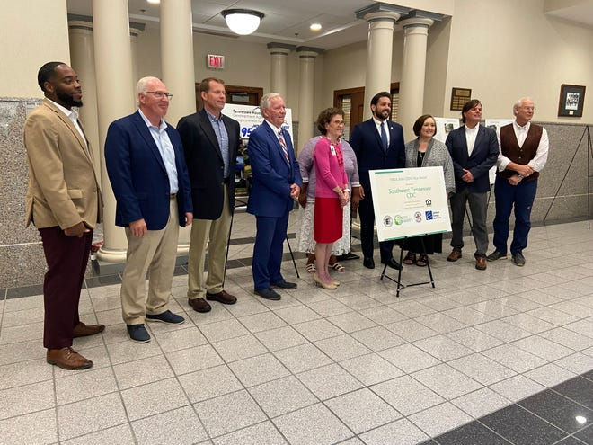Representatives of all involved agencies in Jackson winning the $1 million grant from THDA for six new house constructions gather for photos after the announcement at City Hall on Wednesday, July 14, 2021.