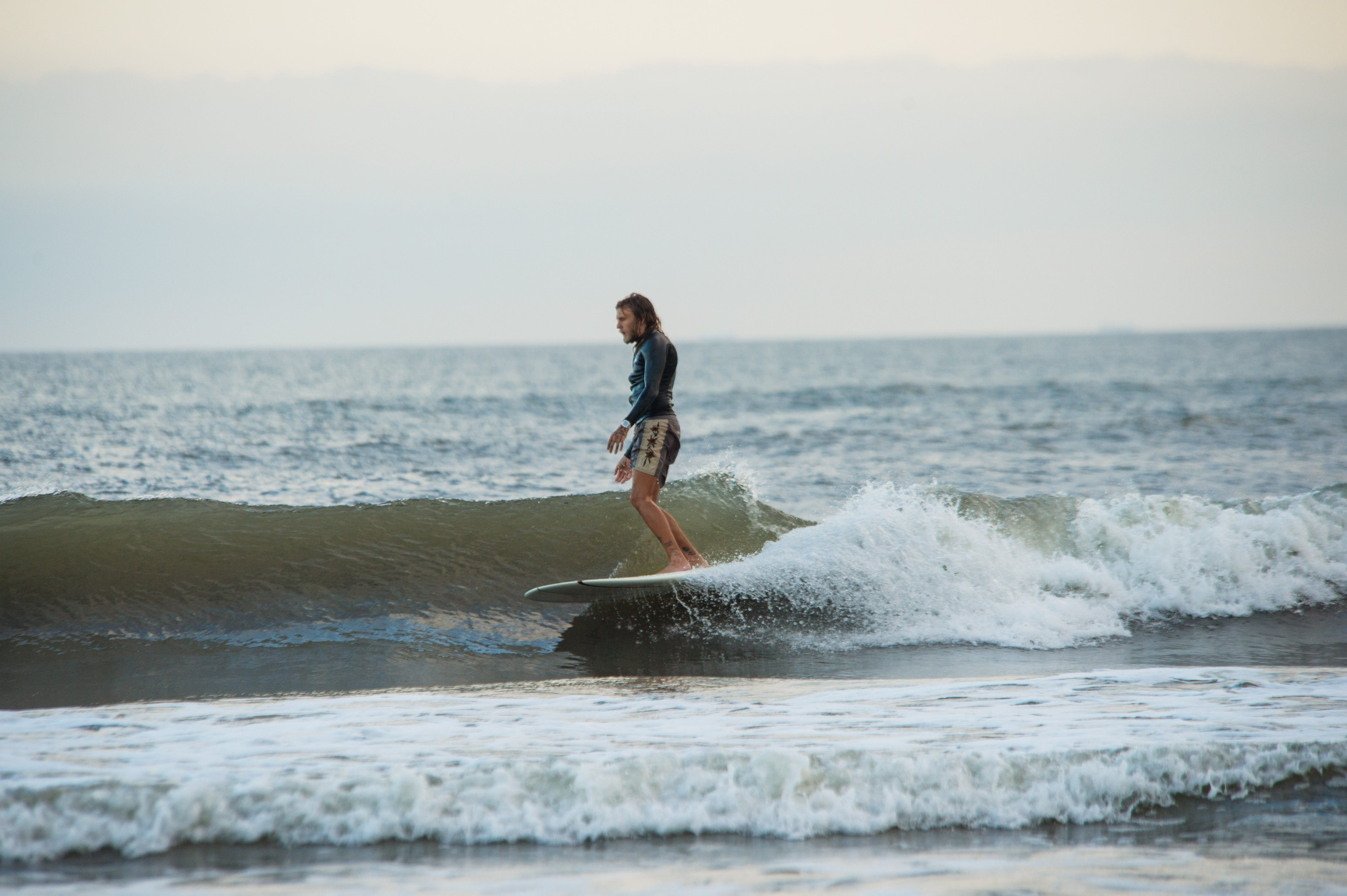 Keegan Matthew catches a wave in Grand Isle. One of his surfing mottos for catching waves in the Gulf of Mexico is