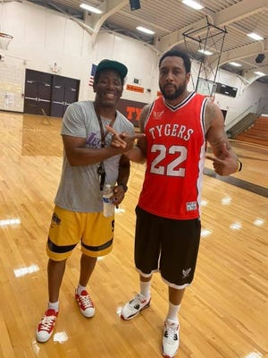 Roy Mack (22) sports a throwback jersey he made for Mansfield Senior legend Ahmed Kent as part of his throwback series for his Brolic Elite Brand. Mack is the founder of Brolic Elite and offers uniform production of every sport.