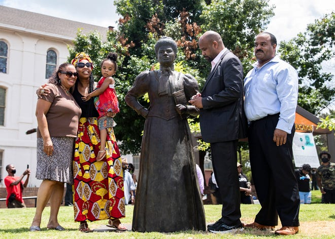 Left, Michelle Duster, Tiana Ferrell, Jasmine, Dan Duster and David Duster pose next to the statue of their relative, Ida B. Wells-Barnett, the African American civil rights advocate and journalist who fought against racism, segregation and lynching, in the new Ida B. Wells Plaza on Beale Street on Friday, July 16, 2021.