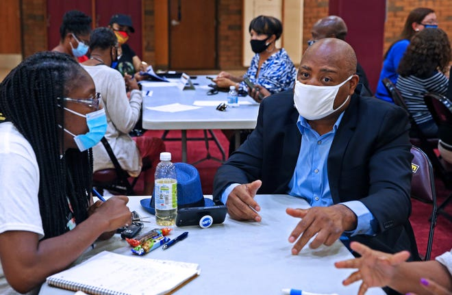 Lonnie Anderson, right, participates in a public engagement event July 15 about spending proposals for the stimulus funds MPS is receiving, while Nicole Finkley, left, listens. The group brainstormed ideas about health and wellness and technology for MPS at Vincent High School.