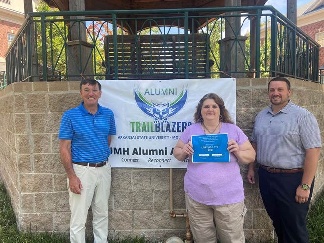 Pictured, from left, are Robin Myers, ASUMH chancellor; Lorynda Tye, scholarship recipient; and Geoff Smith, ASUMH Alumni Association president.