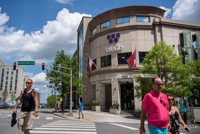 Pedestrians cross Dr. Martin L. King, Jr., Boulevard in front of WeGo Central in Nashville, Tenn., on Friday, July 16, 2021.